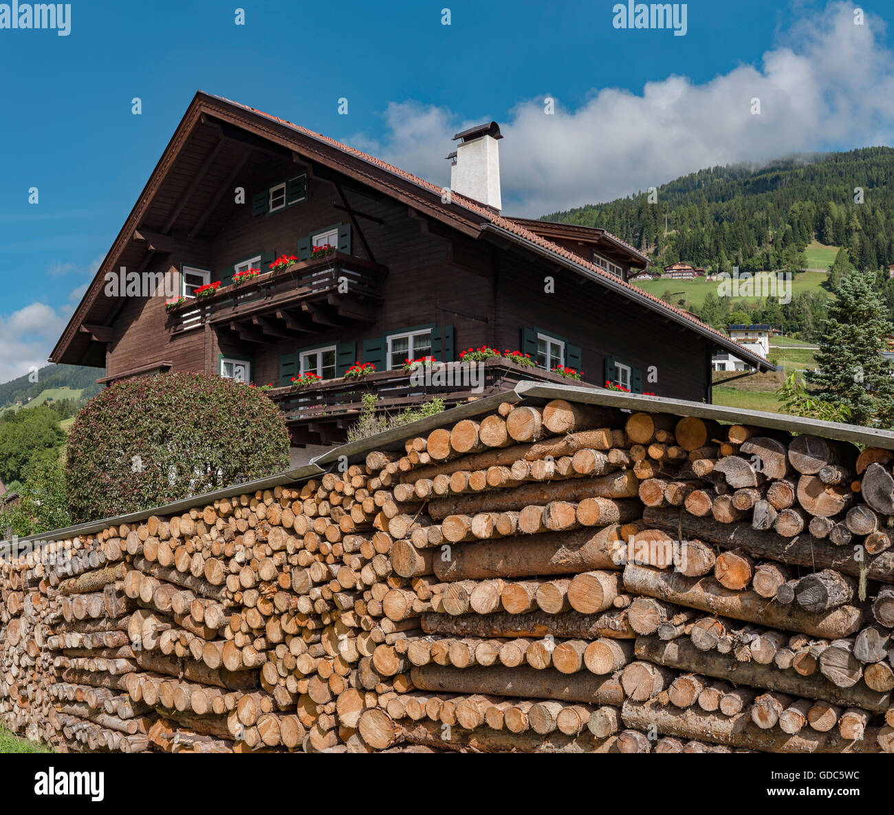Sillian,Austria,Large stock of wood piled up in front of a house - Stock Image