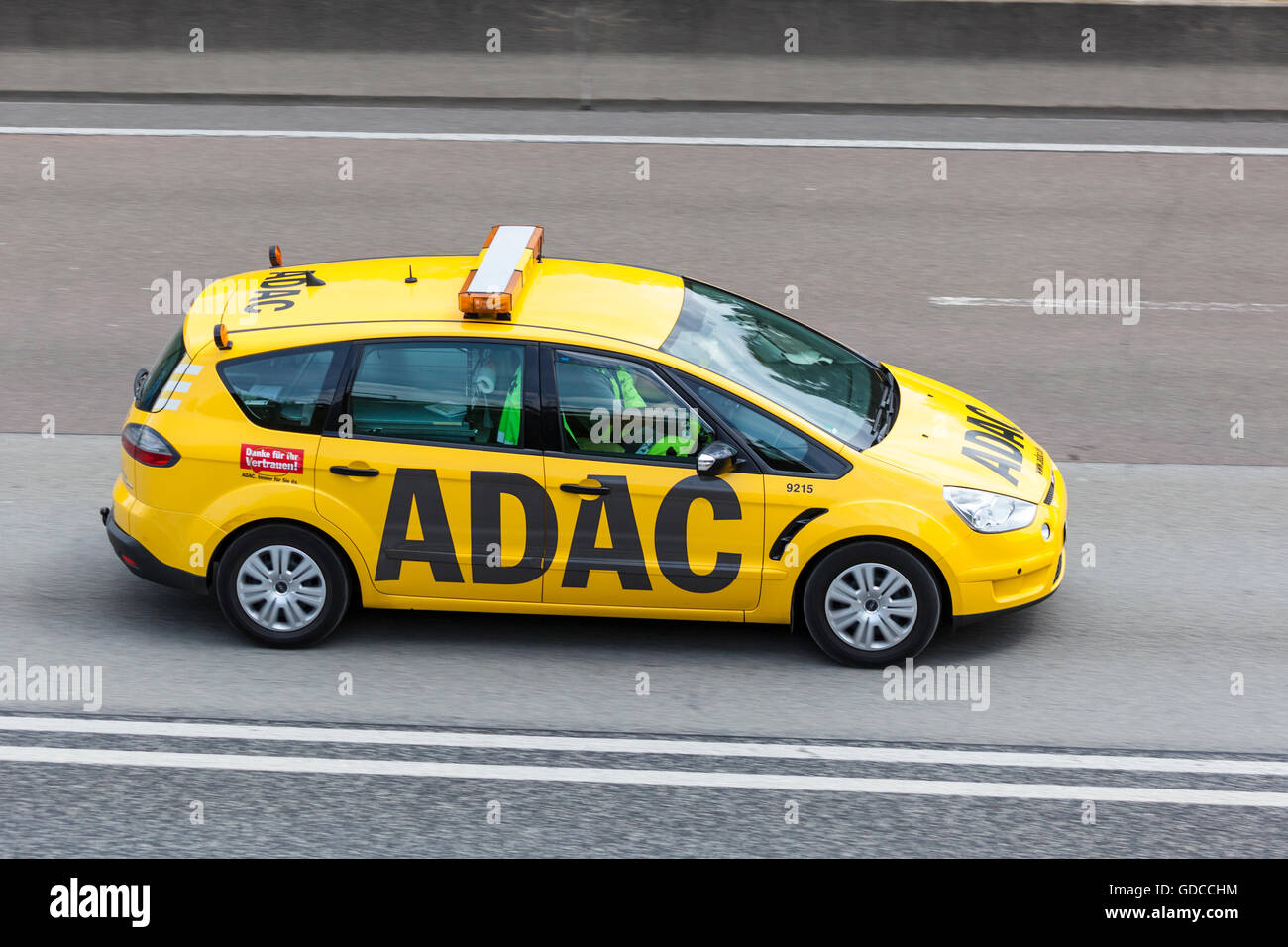 Yellow ADAC Ford S-Max on the highway - Stock Image