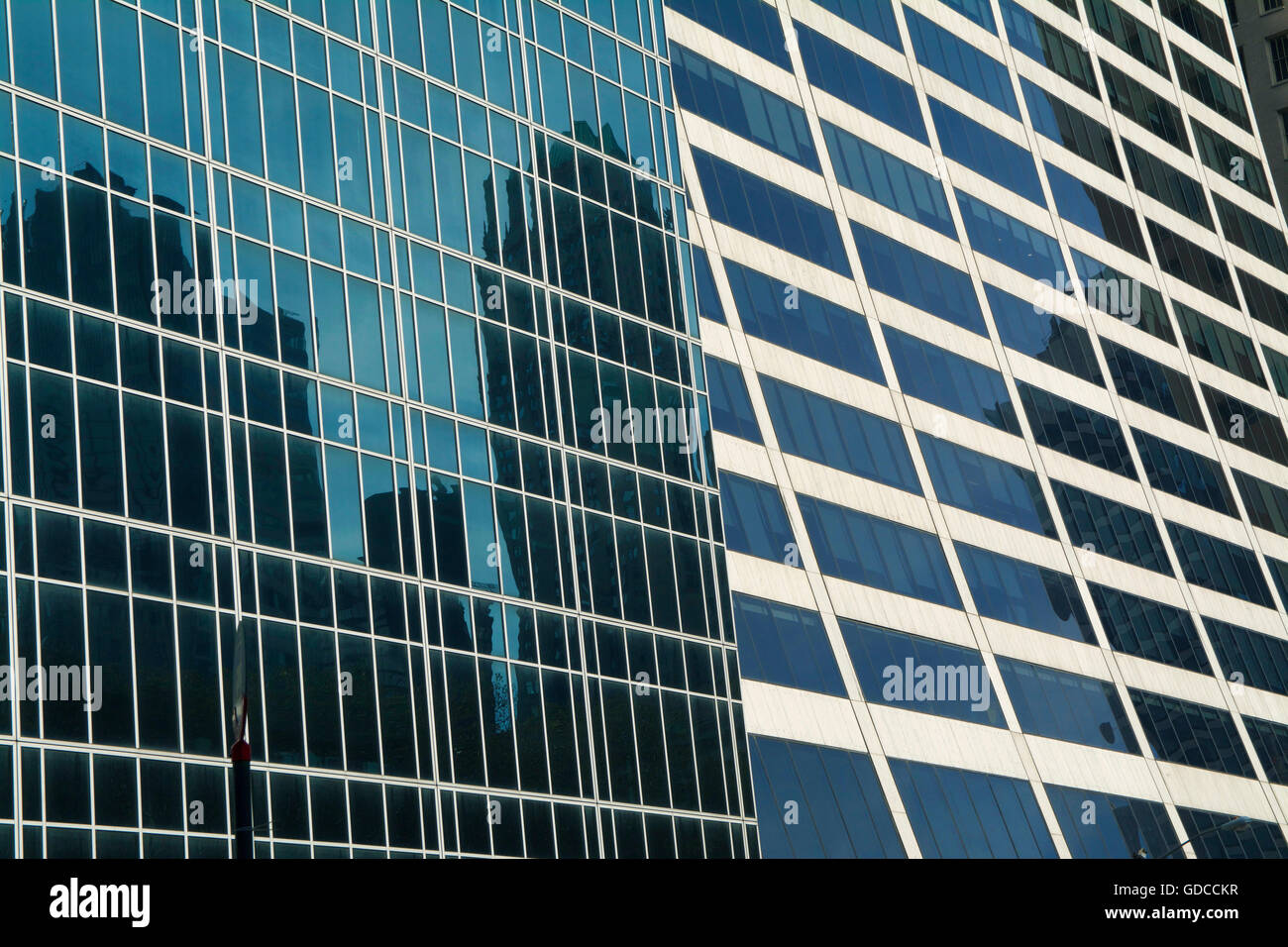 Blue skyscraper office buildings located in downtown New York City reflecting images of adjacent skyscrapers Stock Photo
