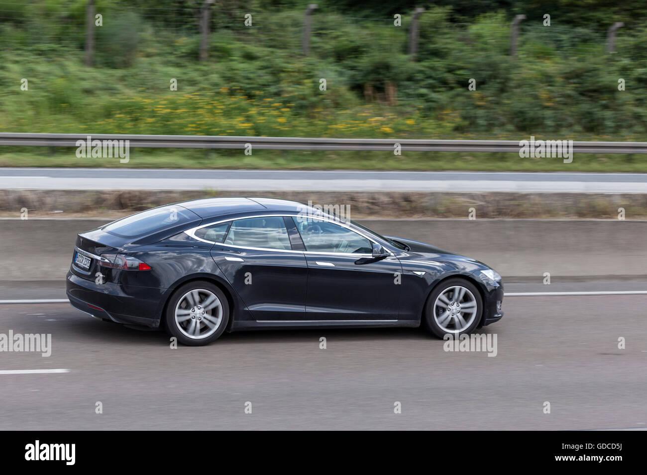 Tesla Model S on the highway Stock Photo
