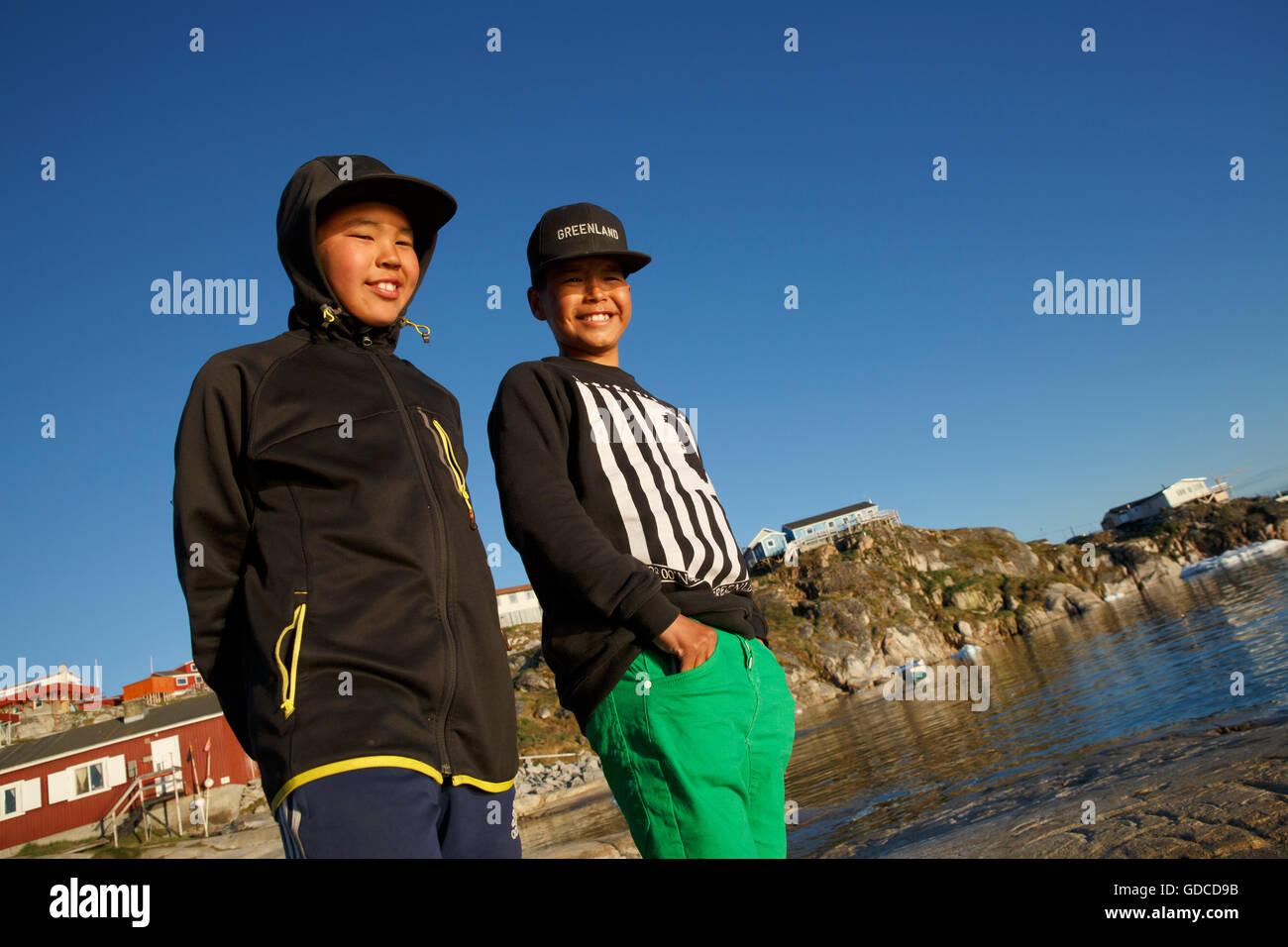Inuit boys on the shore, Ilulissat, Greenland - Stock Image