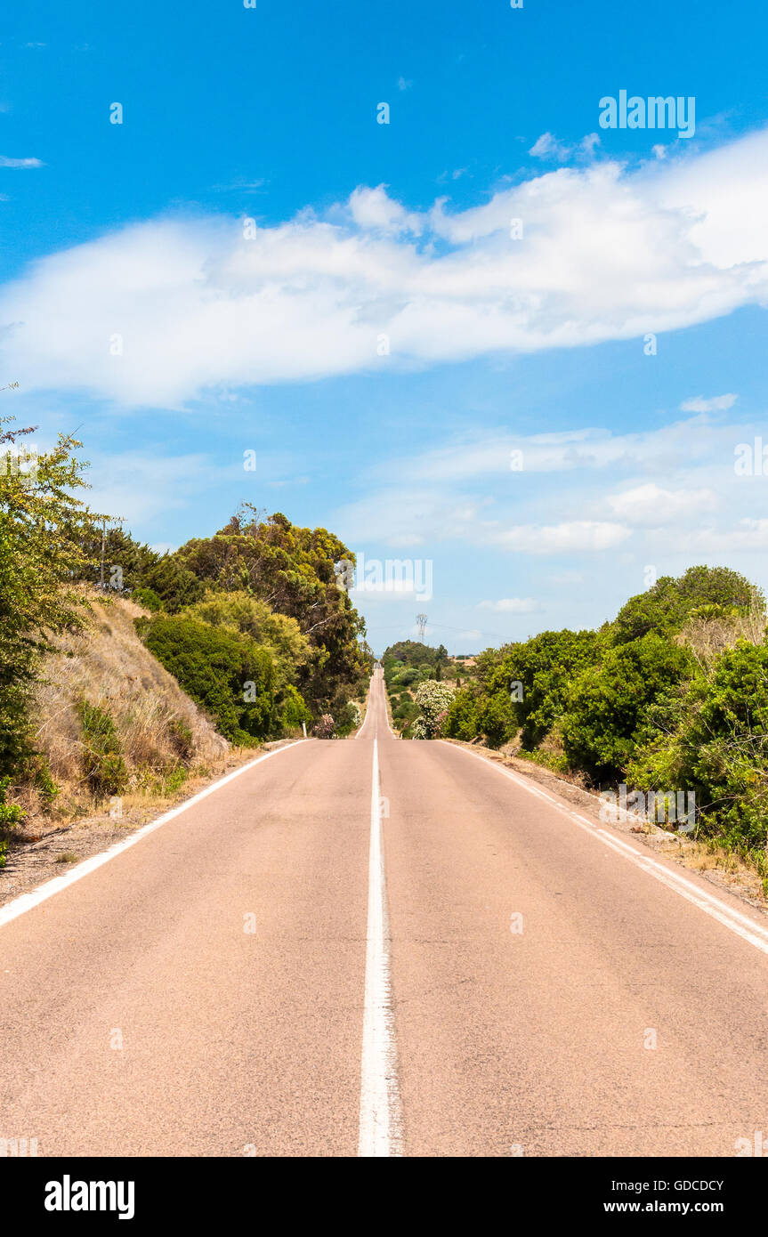 Desert country road in a sunny day of summer - Stock Image