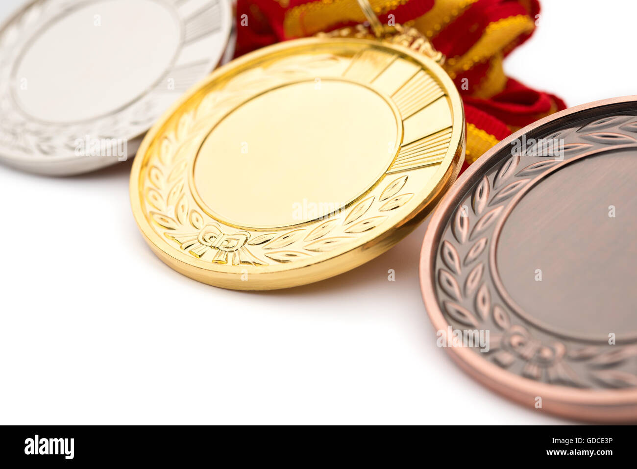 set of gold silver and bronze award medals on white background - Stock Image