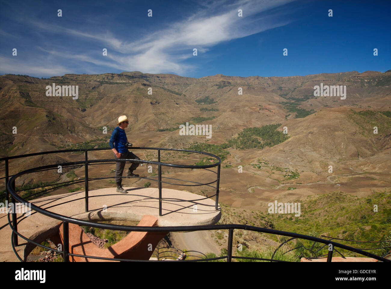 Western traveller taking in the view from the top of the Ben Abeba restaurant, Lalibela, Ethiopia - Stock Image