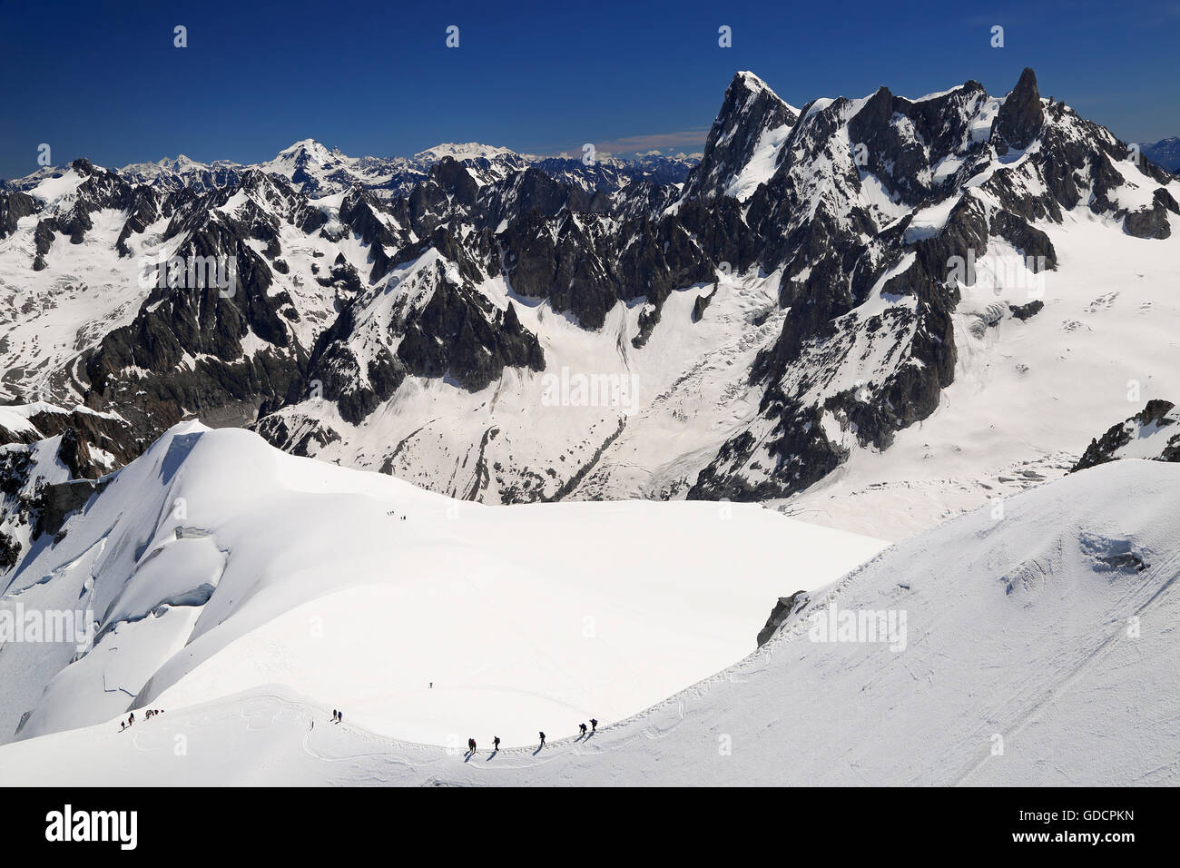 Climbers on French Alps Mountains near Aiguille du Midi, France, Europe - Stock Image