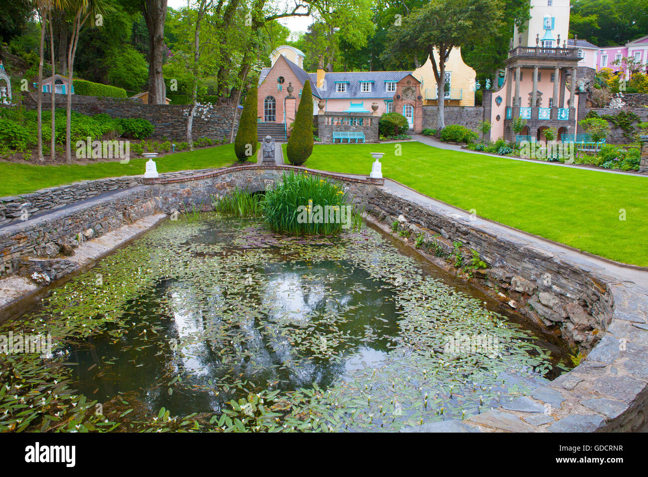 Fishpond, Portmeirion, with Salutation and Gloriette buildings beyond. Stock Photo
