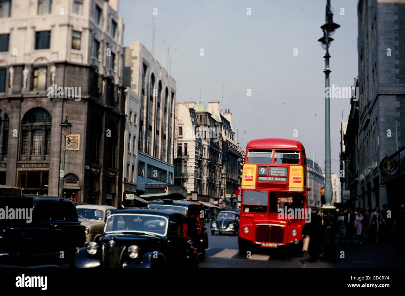 The Strand, London with Routemaster double decker bus and cars and showing the Civil Service Stores and the High - Stock Image