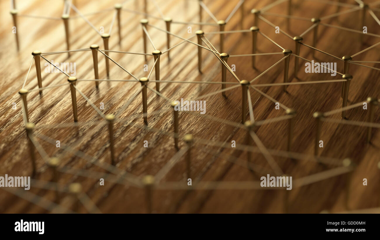 Network, networking, connect, wire. Linking entities. Network of gold wires on rustic wood. Nails connected with - Stock Image