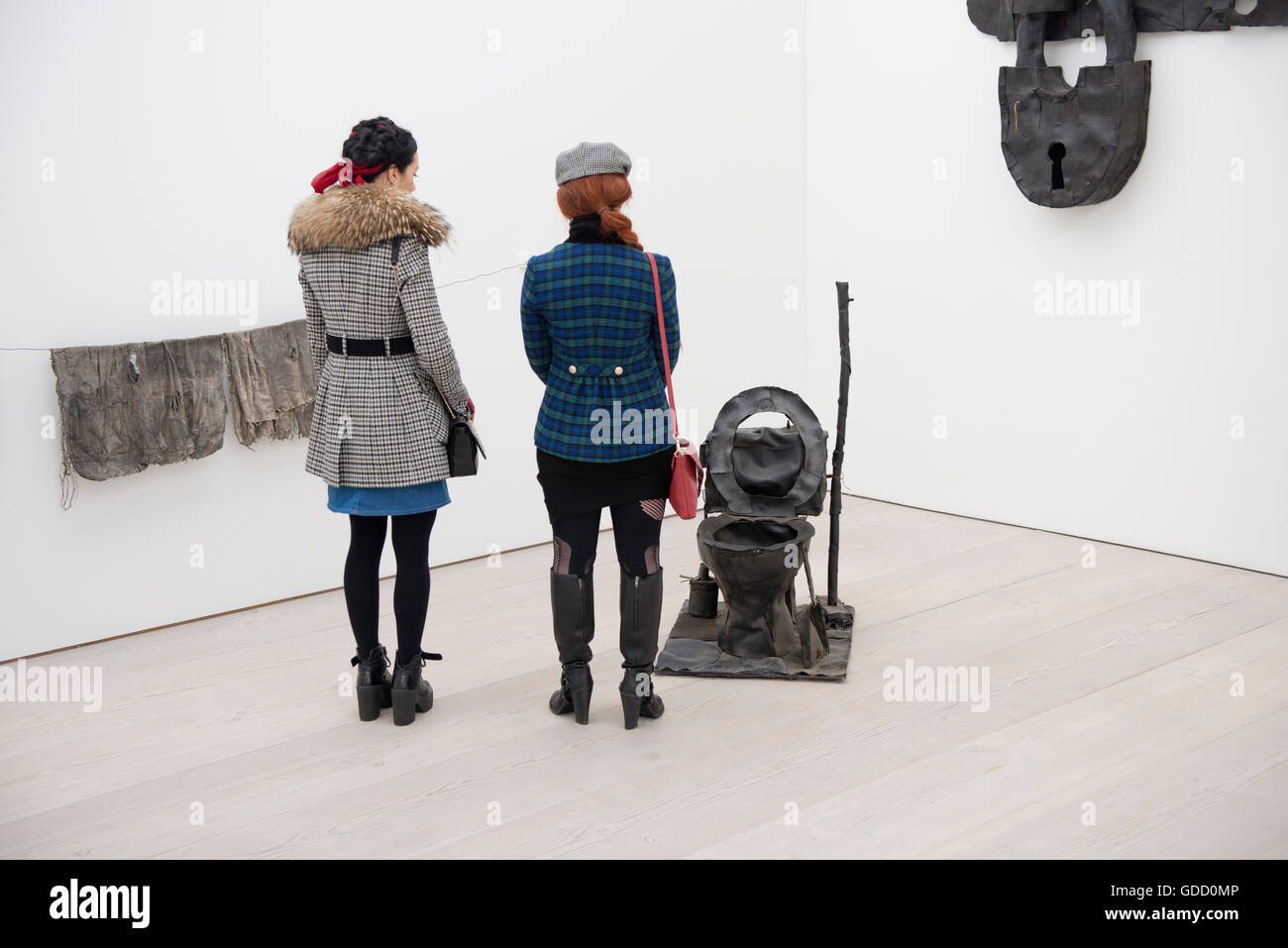 two women viewing contemporary art installation at saatchi gallery london - Stock Image
