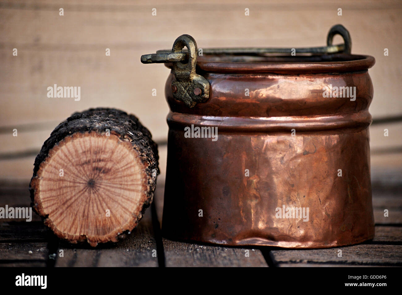 copper cauldron and round wood - Stock Image