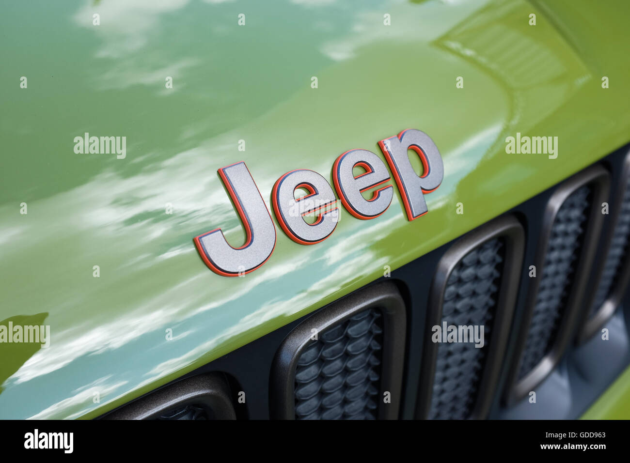 The word 'Jeep' on a green Jeep vehicle. - Stock Image