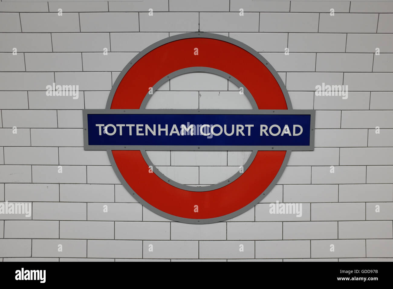 A tube sign at Tottenham Court Road underground station in London, England. - Stock Image