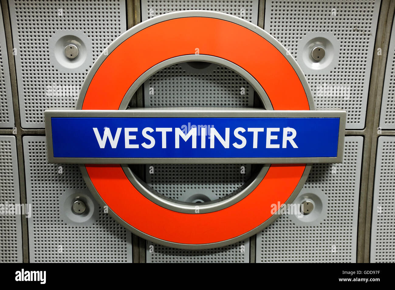 A tube sign at Westminster underground station in London, England. Stock Photo