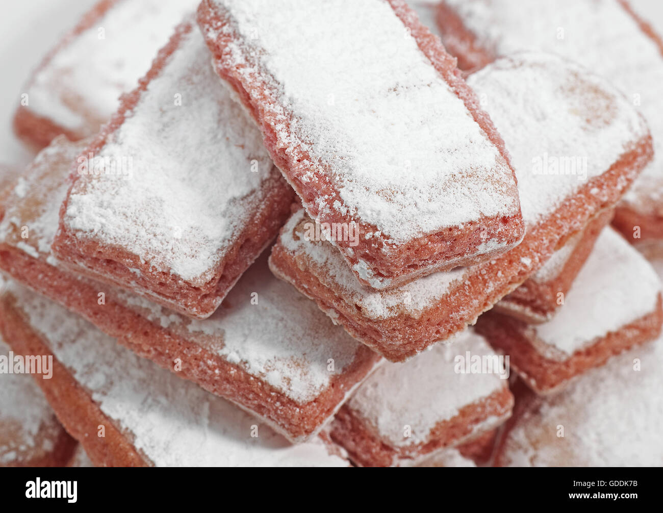 Biscuit Rose de Reims, Pink Biscuit found in French cuisine, It is customary to dip the biscuit in champagne - Stock Image