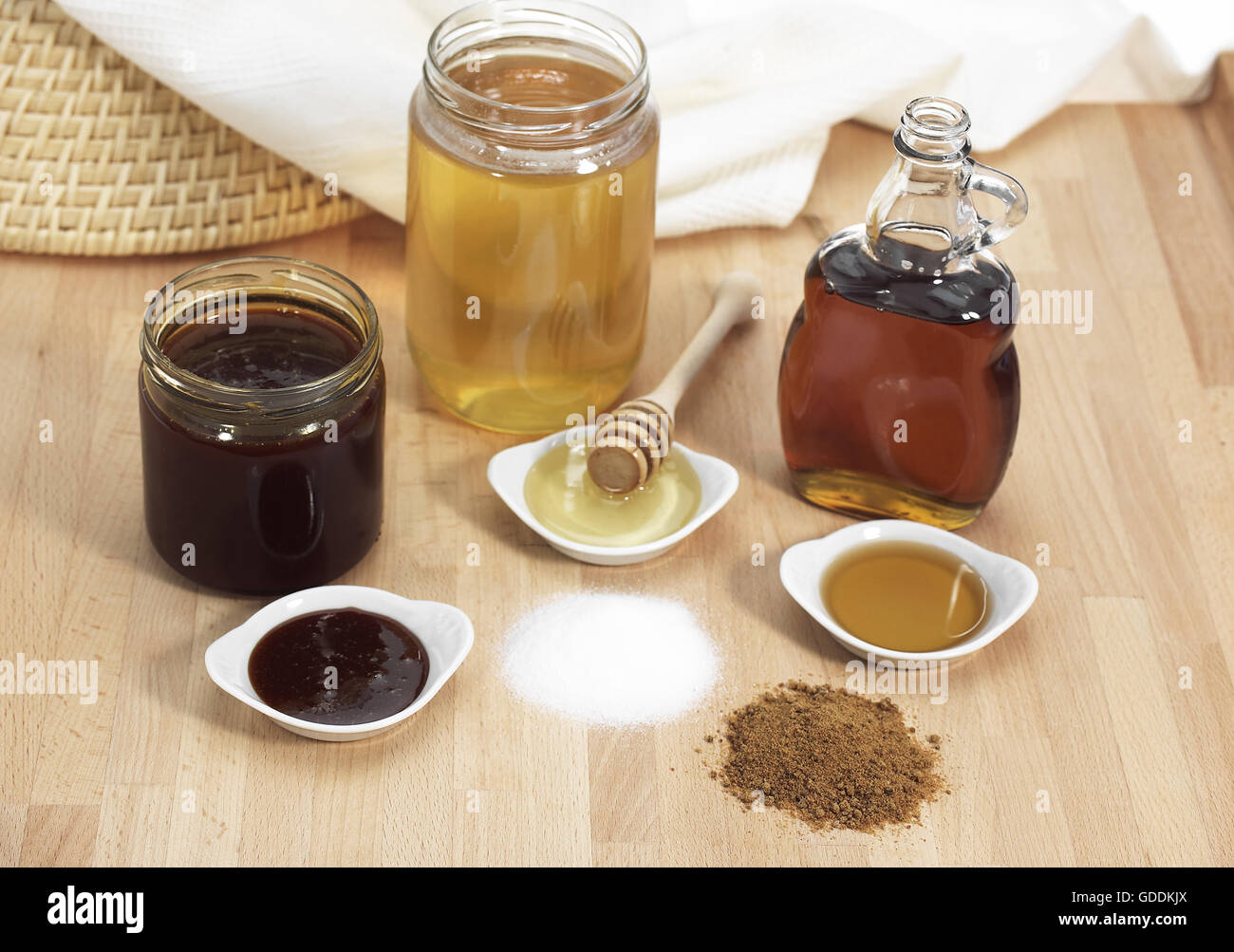 Fine Granulated Sugar, Brown Sugar, Maple Syrup, Treacle and Honey - Stock Image