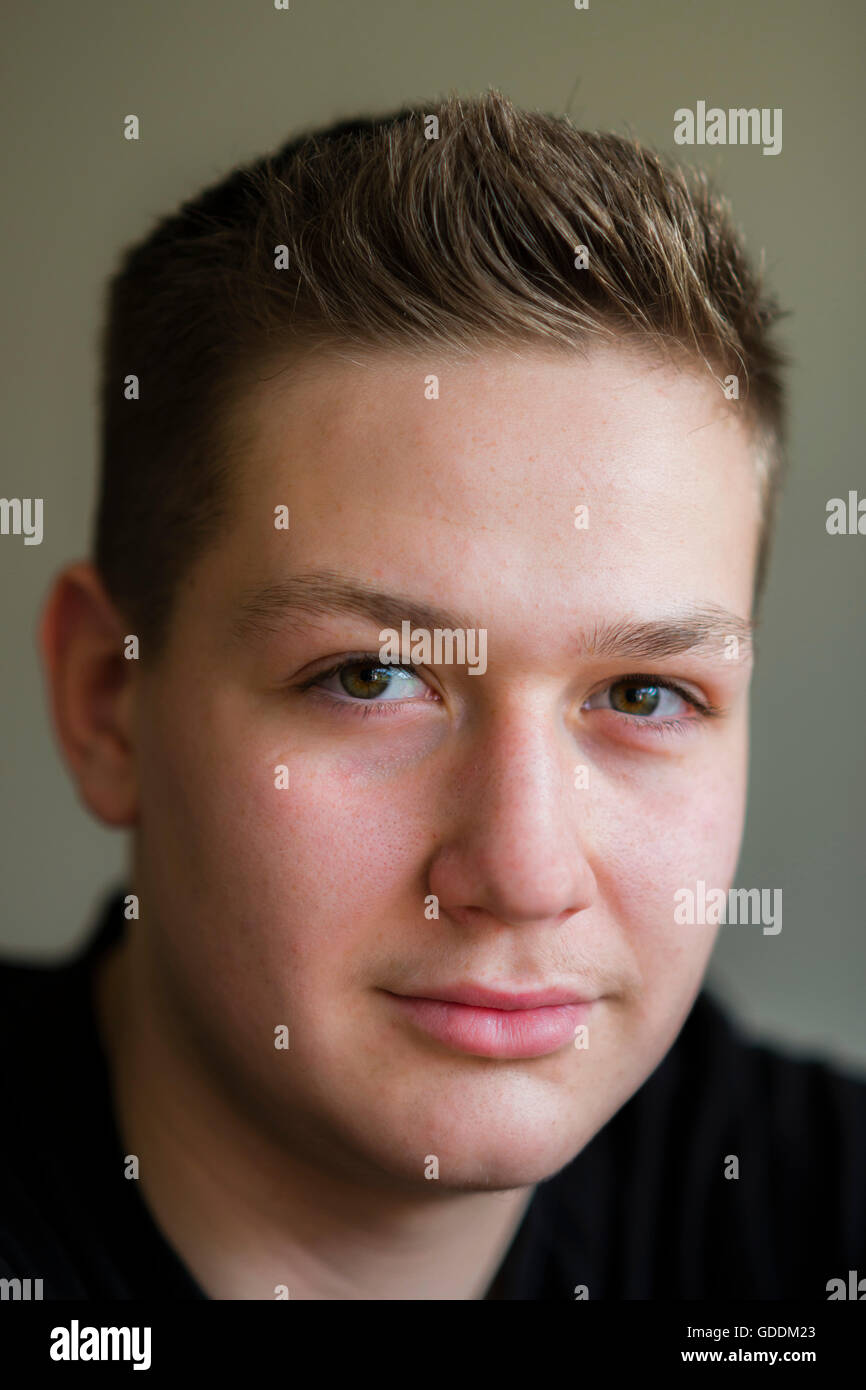 14-16 years,15 years,Germany,direct,look,glance,person,single person,Europe,face,acne,skin,skin problem,boy,Europe - Stock Image