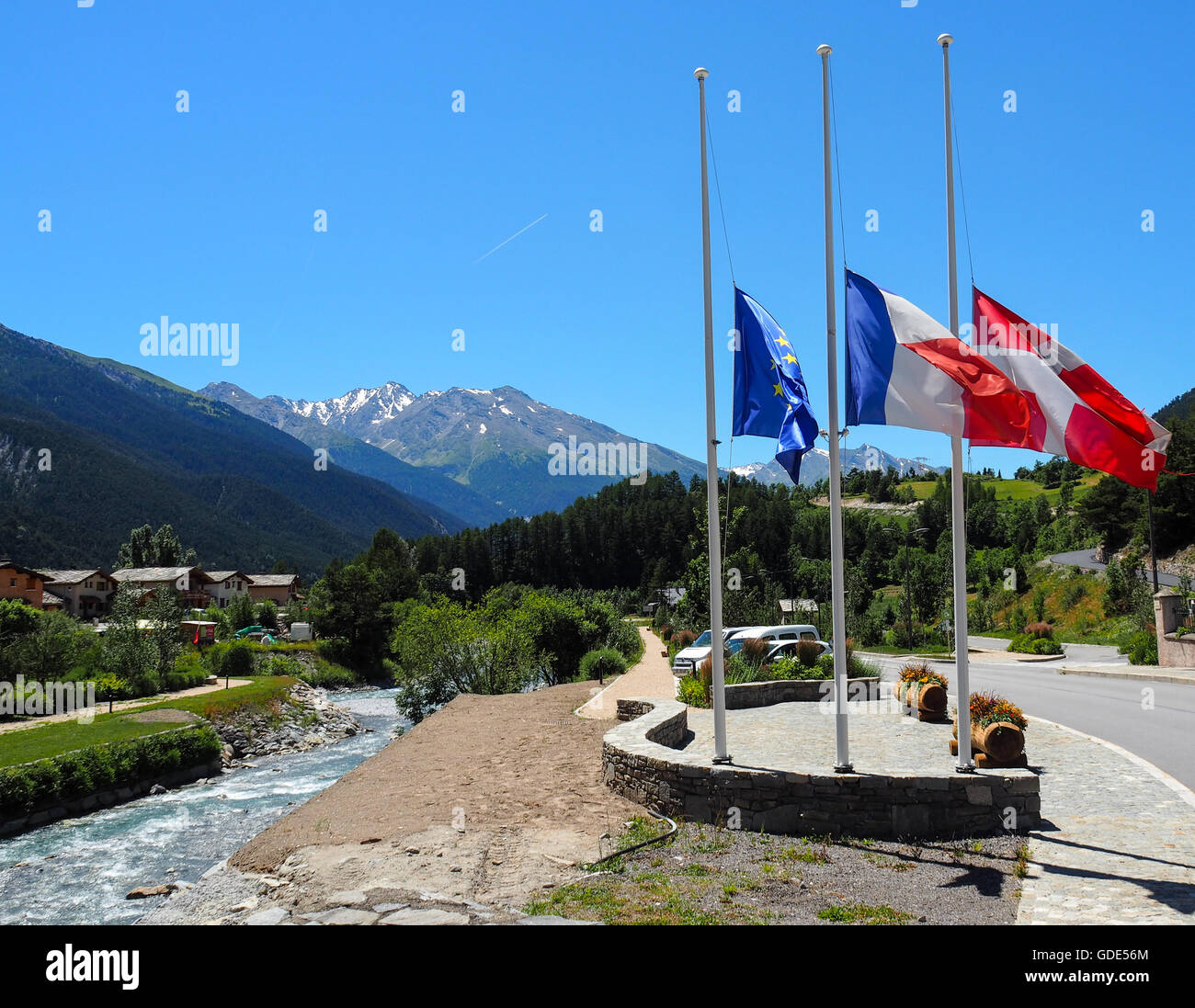 Termignon, France. 16th July, 2016. Flags fly at half mast in the Alpine Village as a mark of respect for those - Stock Image