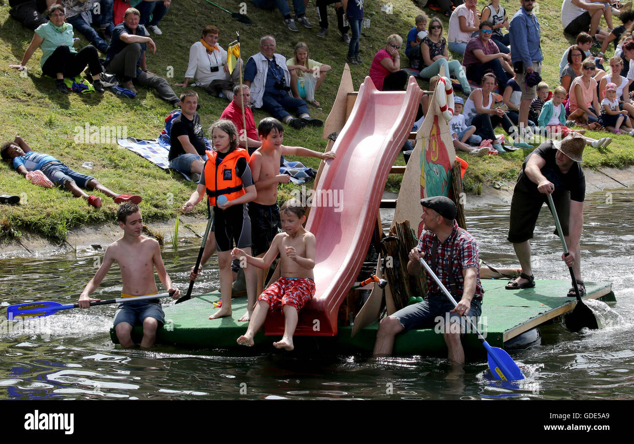 Plau am See, Germany. 16th July, 2016. A waterborne water slide pictured during the 'Badewannenrallye' (lit. - Stock Image
