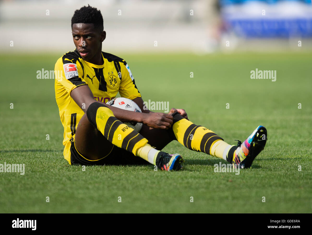 Munich, Germany. 16th July, 2016. Ousmane Dembele of premiere league team Borussia Dortmund sits on the ground in - Stock Image