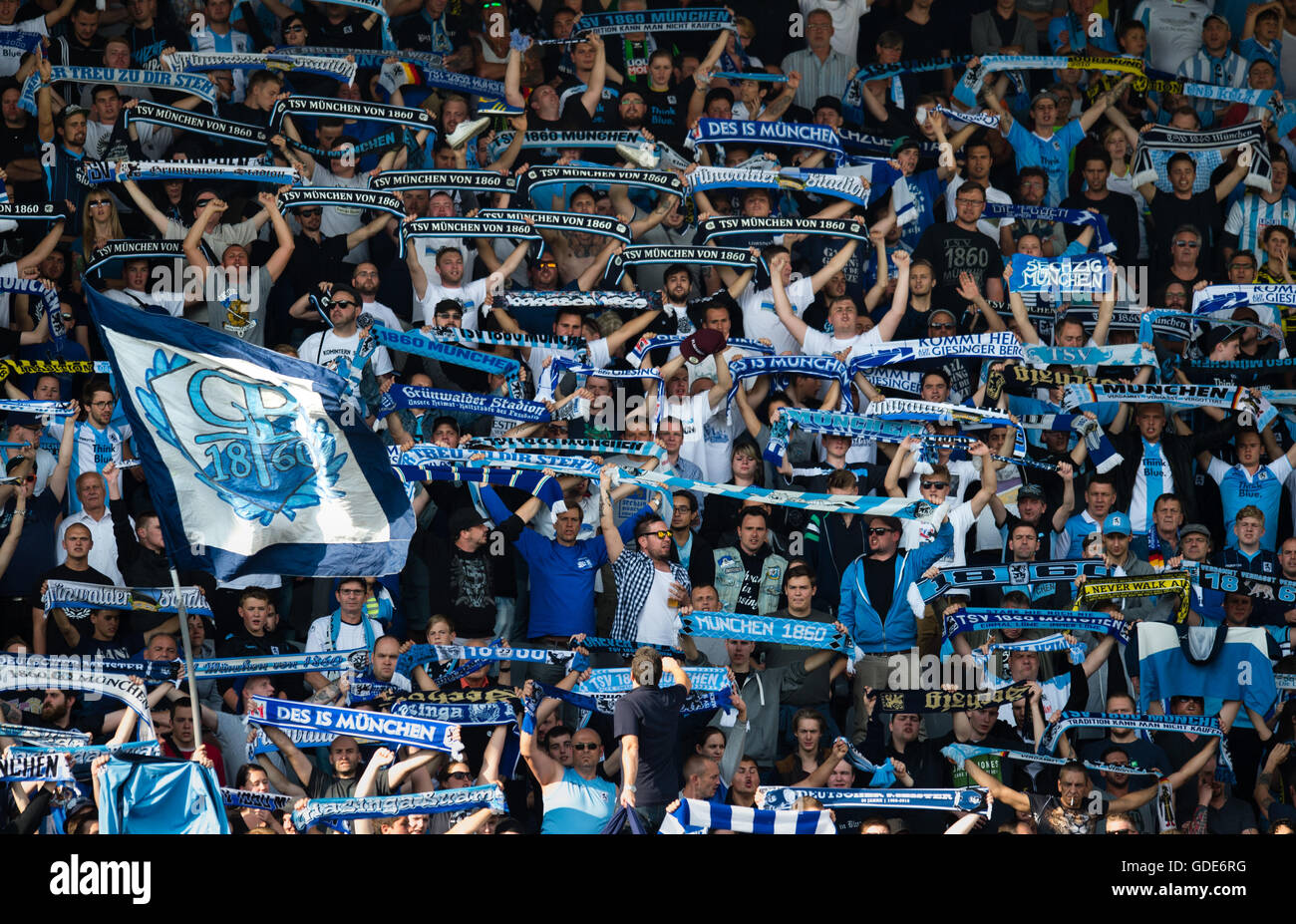 Munich, Germany. 16th July, 2016. Supporters of the second divison team TSV 1860 Munich hold up their fan scarfs - Stock Image
