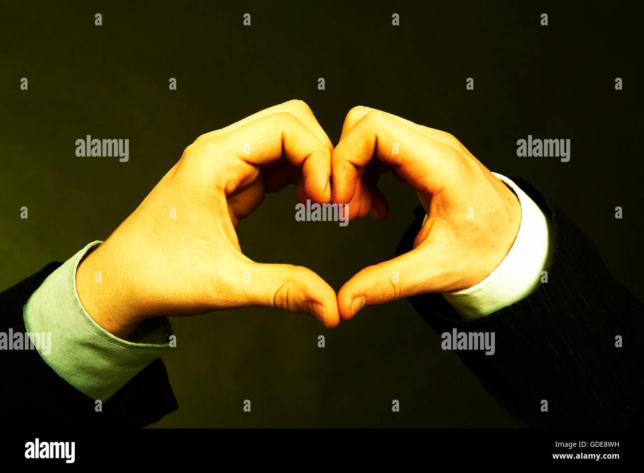 Hands,hand,Merger,union,unite,fit,business,men,economy,heart - Stock Image