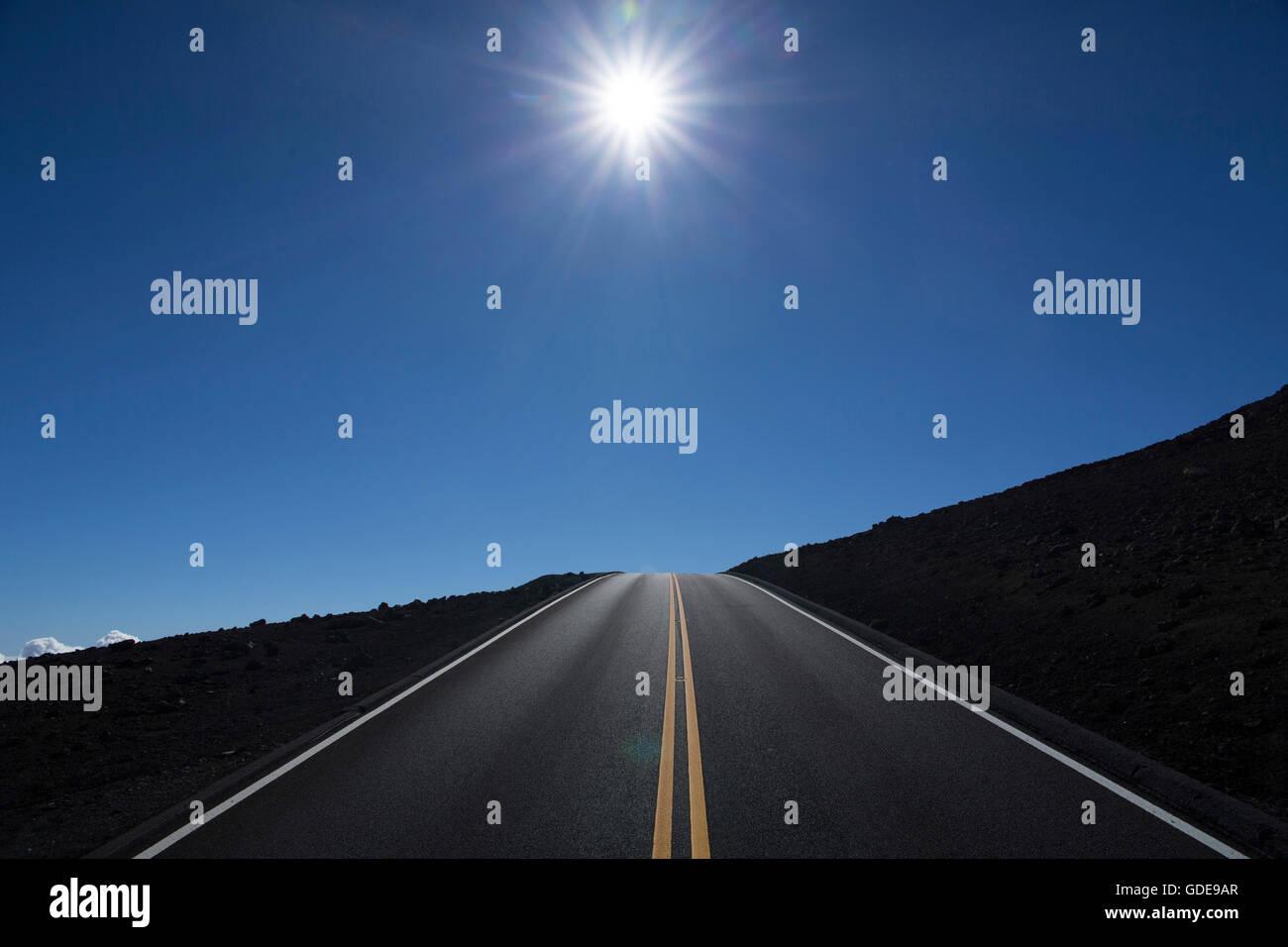 Maui,street,sun,straight,Puu Ulaula,Haleakala,crater,USA,Hawaii,America,Volcanical,lava, - Stock Image