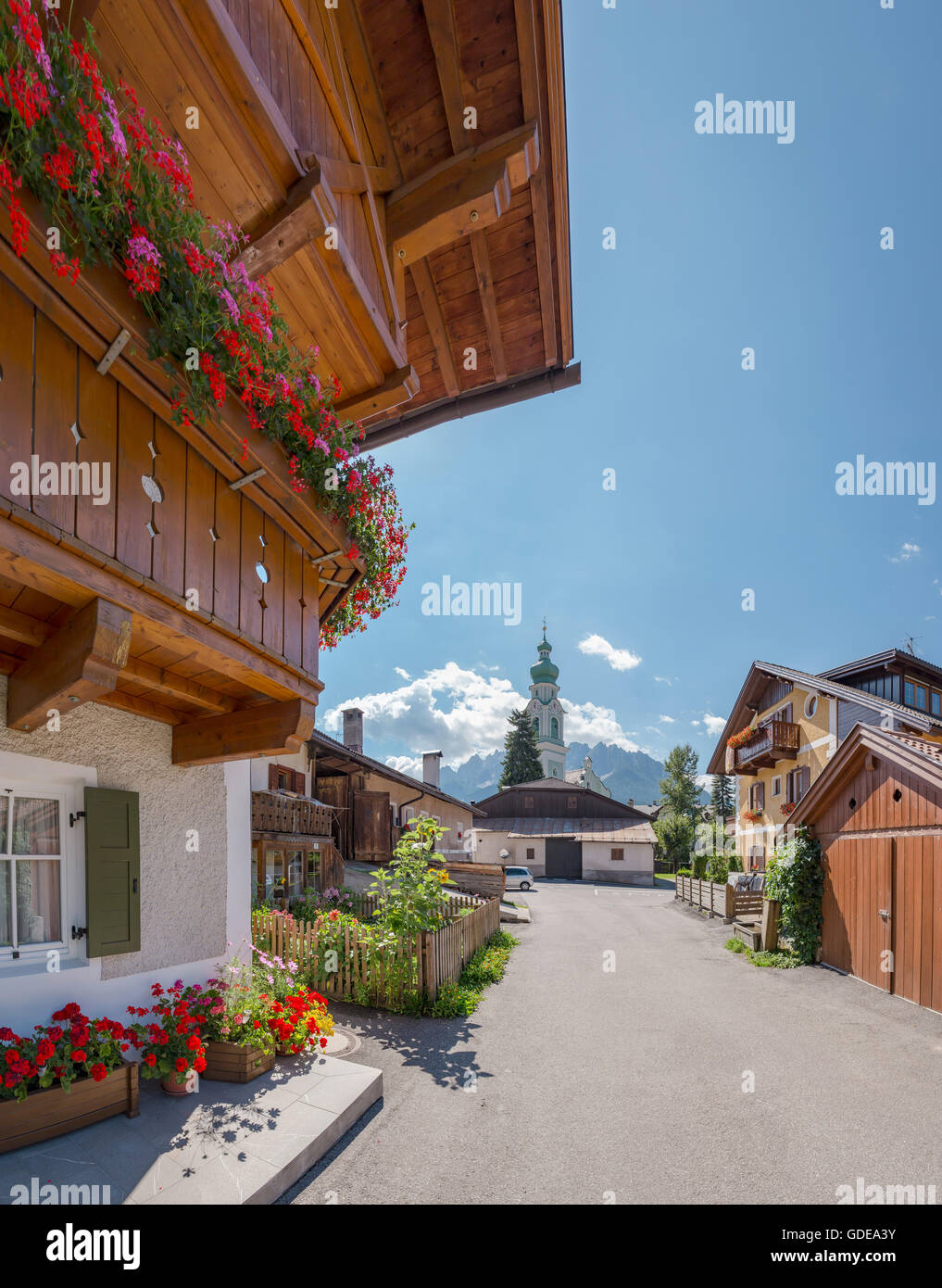 Toblach,Dobbiaco,Italia,Chalets with balconies full with flowers - Stock Image