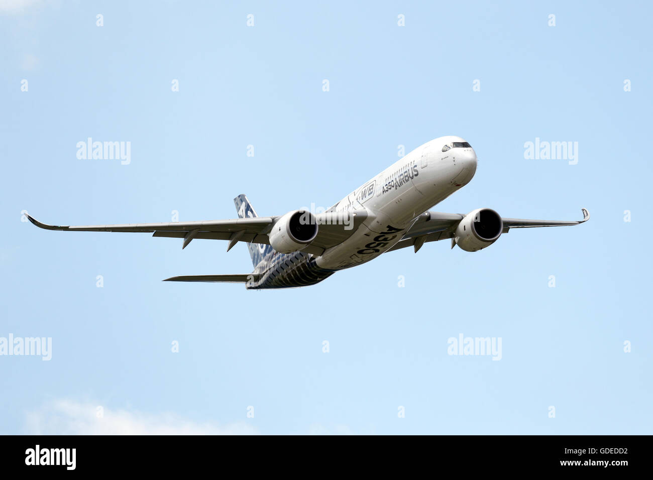 An Airbus A350 flies during the Farnborough International Airshow in July 2016 Stock Photo