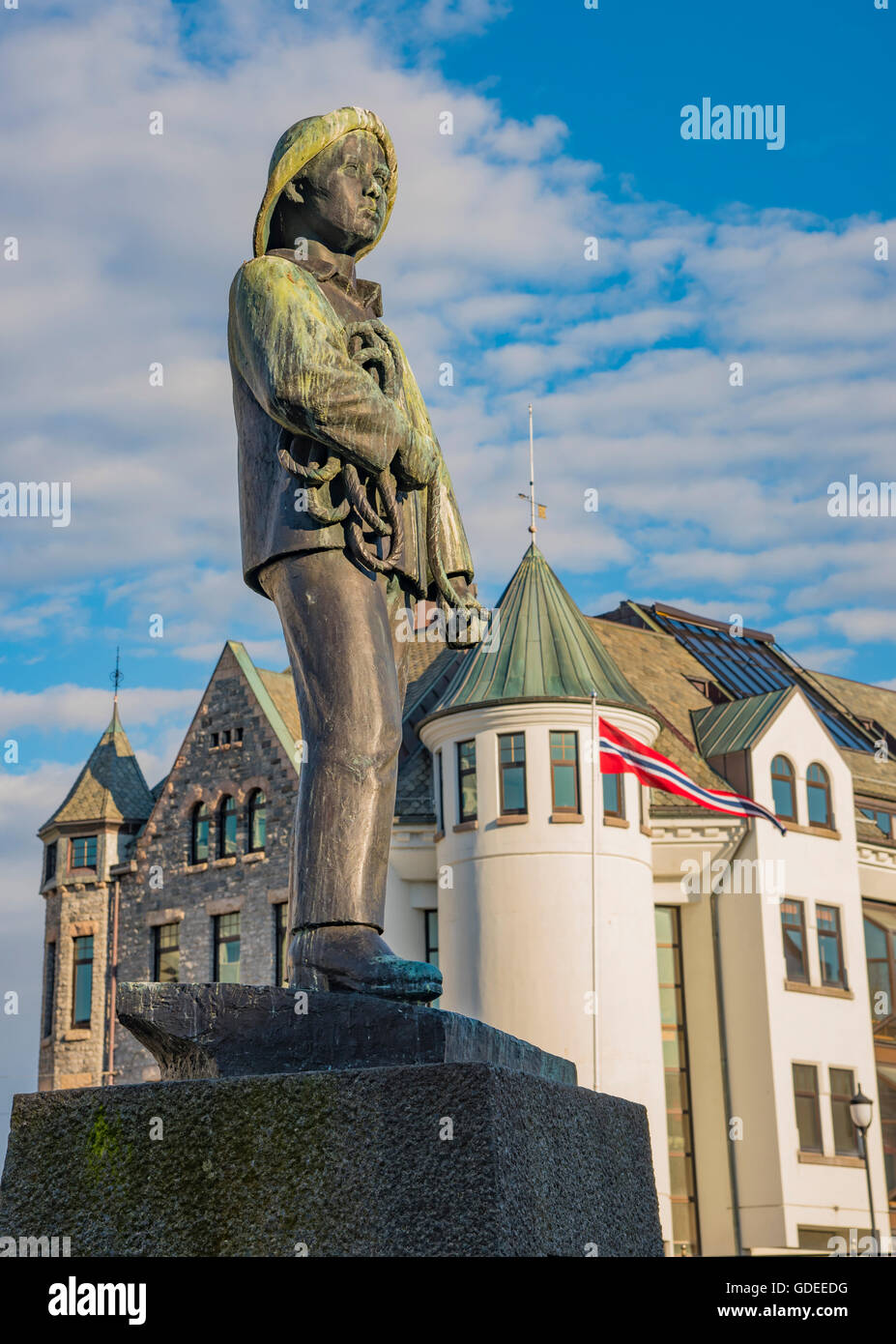 Statue of young sailor-fisher boy on Brosundet Canal and Pier. Alesund, Norway, More og Romsda, Scandanavia, Europeanl - Stock Image