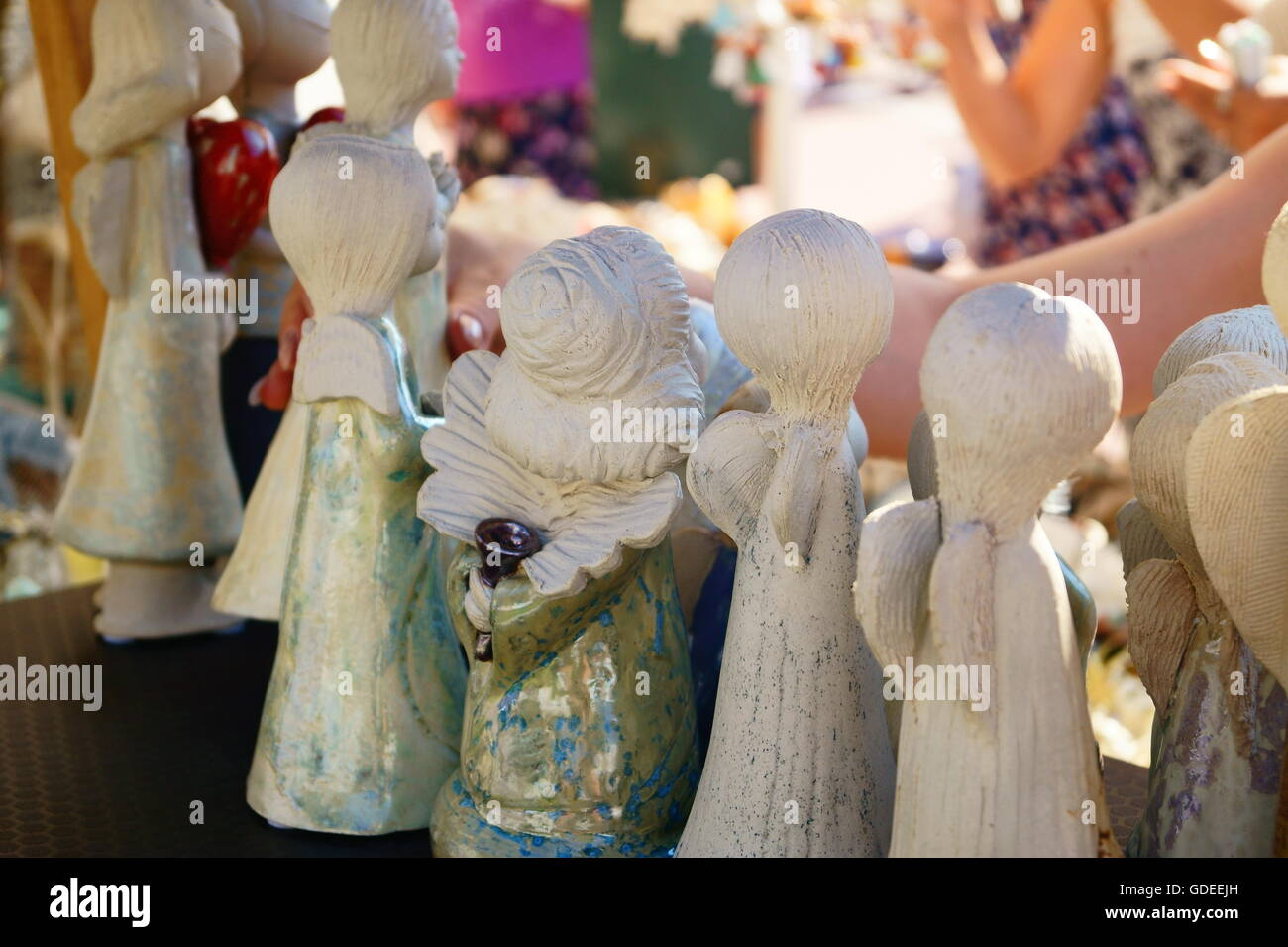 the figurines of angels on outdoor marketplace the fair organized by the city festival in - Christmas Angels For Sale
