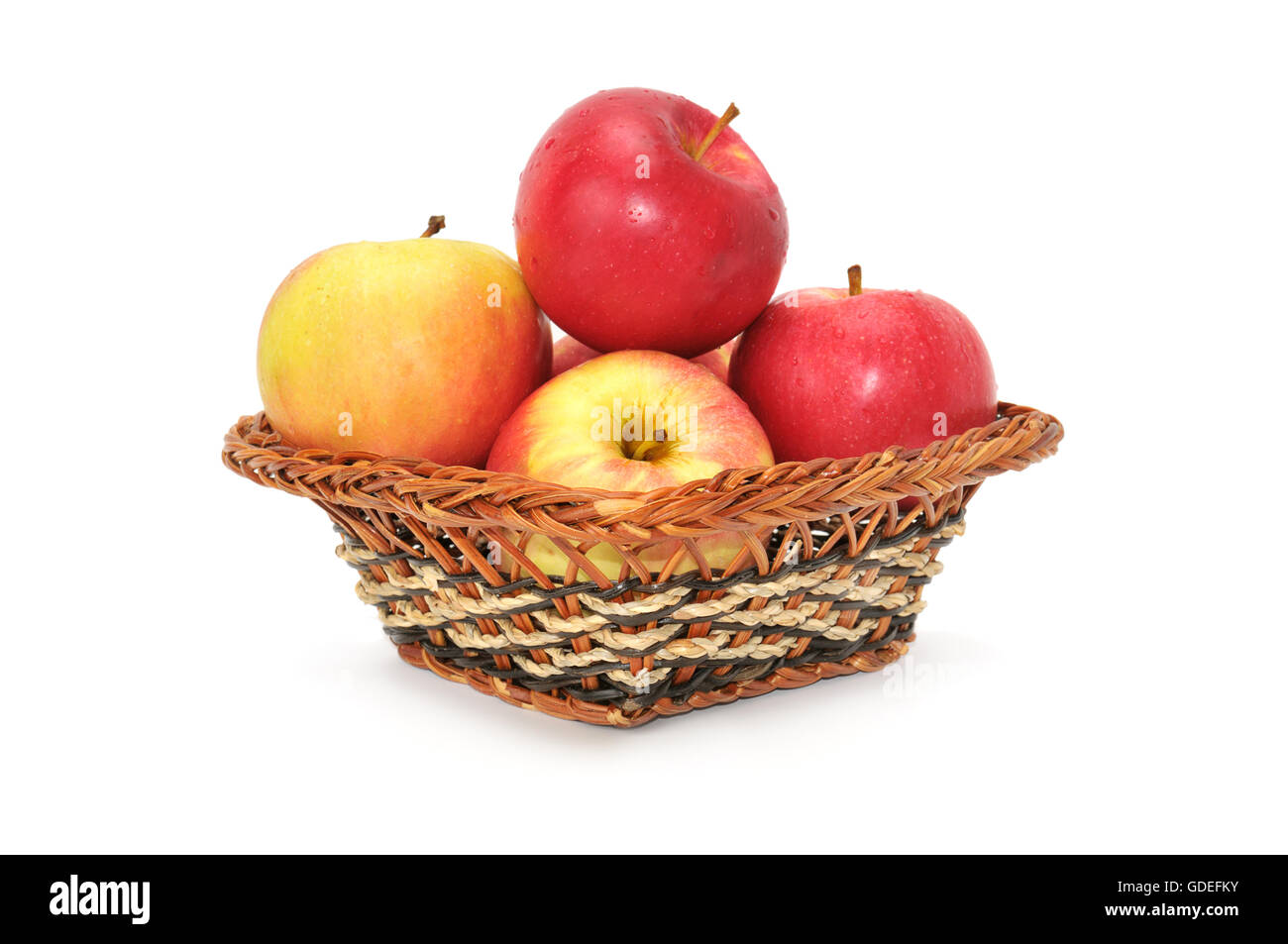 apples in basket isolated on a white - Stock Image