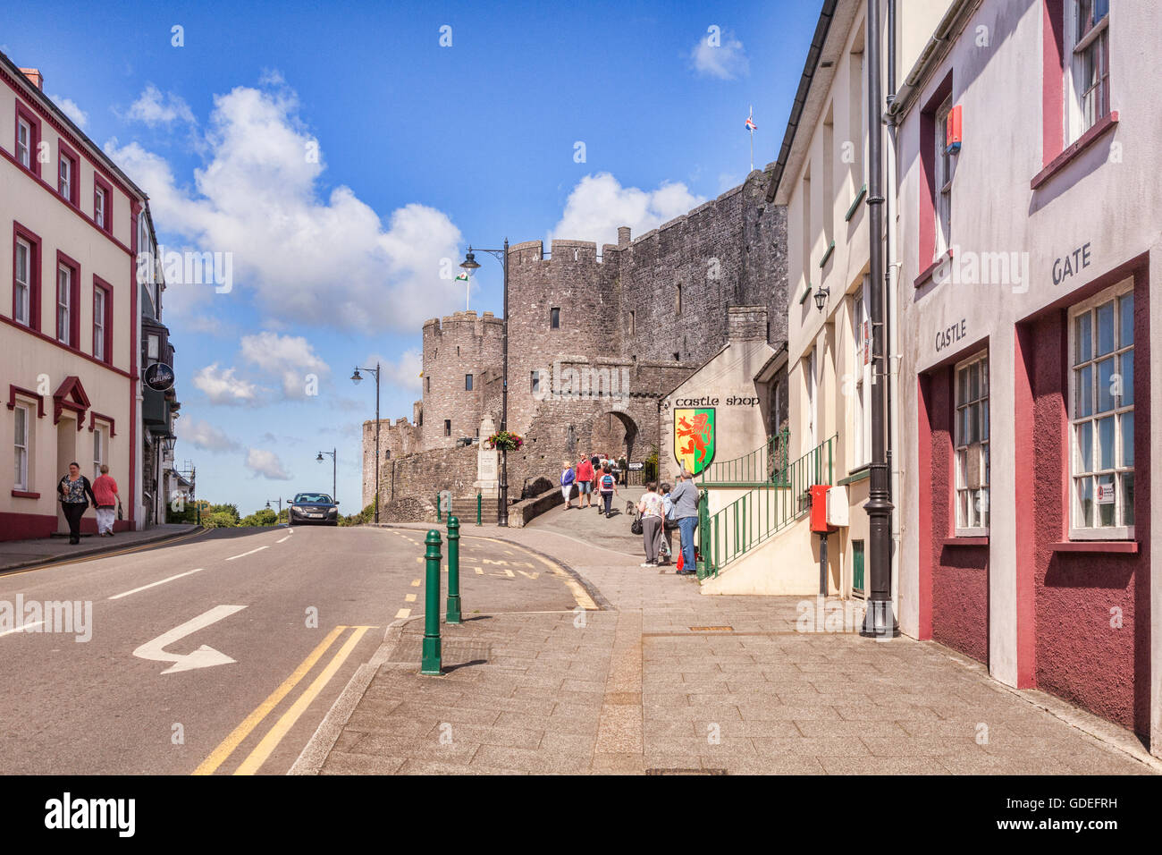 View towards the entrance to Pembroke Castle on Westgate Hill, Pembrokeshire, Wales,UK. - Stock Image