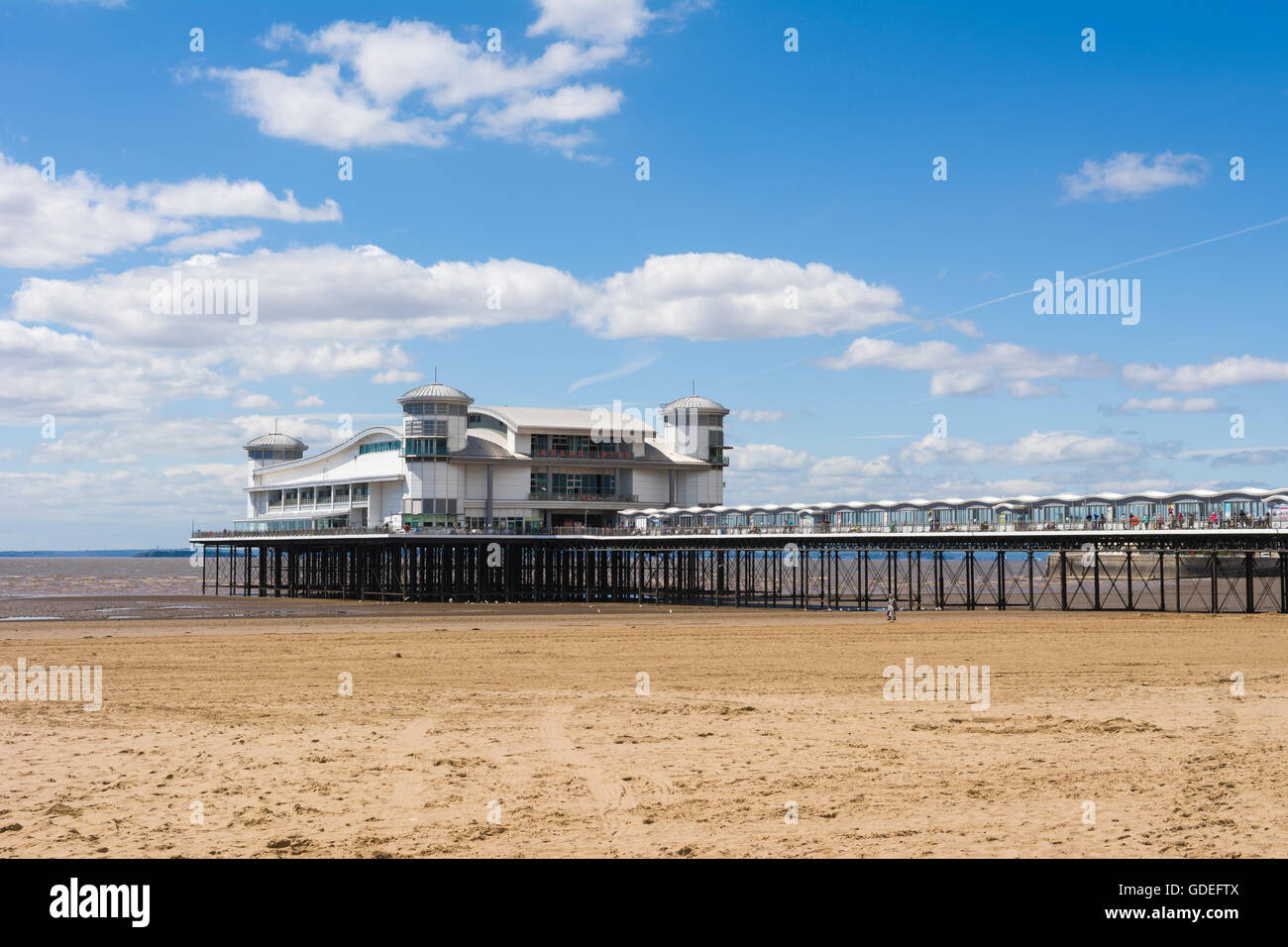 The Grand Pier at Weston-super-Mare Beach, North Somerset, England - Stock Image