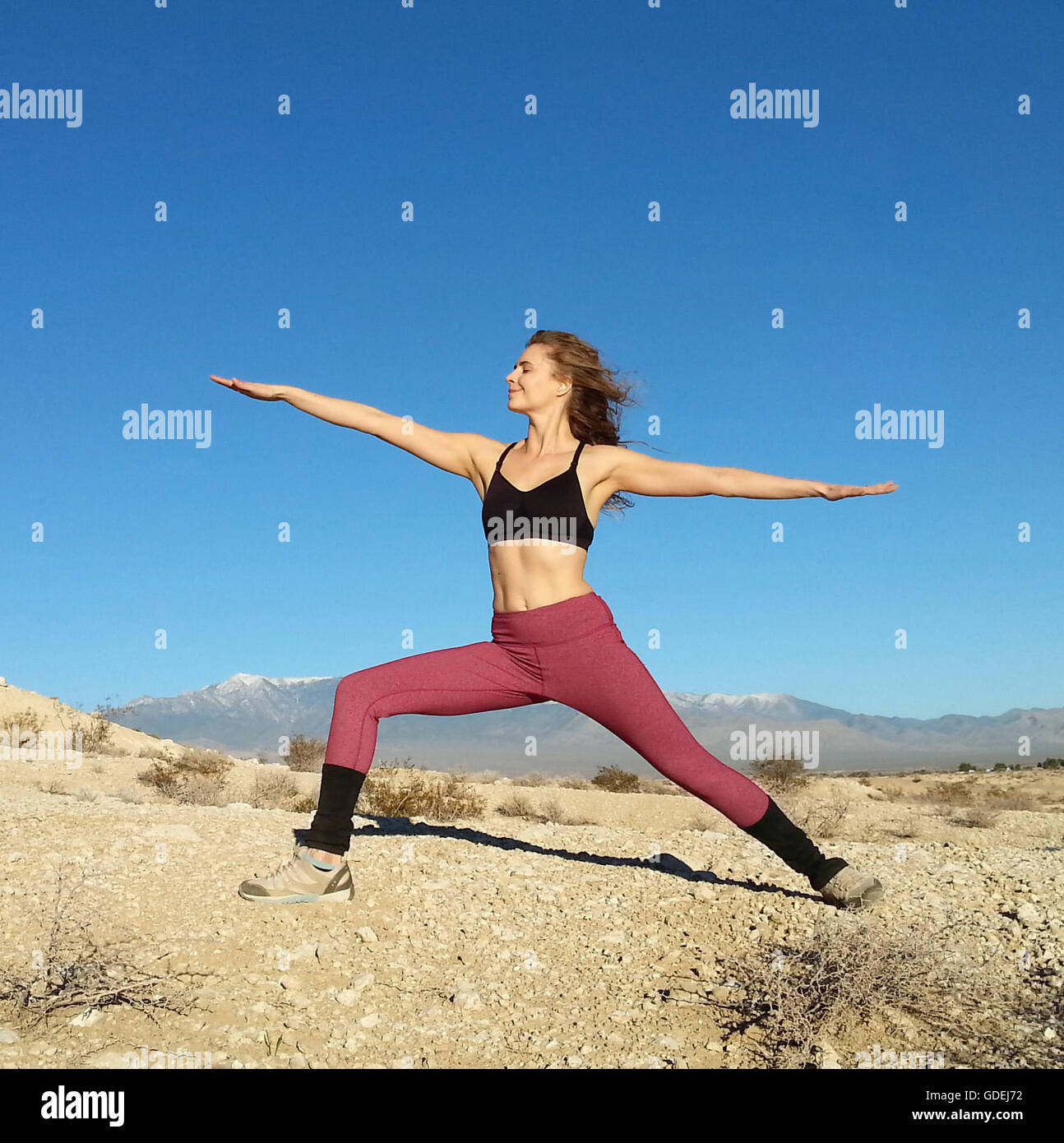 Woman doing a warrior pose, Nevada, America, USA - Stock Image