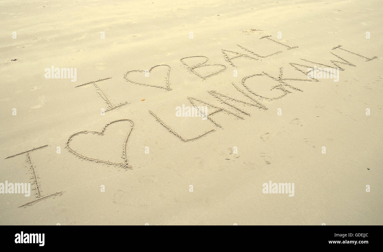 I love bali and langkawi written in sand on beach - Stock Image