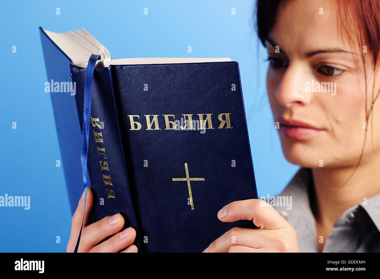 woman reading holly   bible with cyrillic alphabet - Stock Image