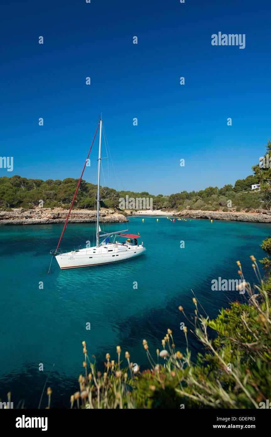 Sailing boat at Cala Sa Nau, Mallorca, Majorca, Balearic Islands, Spain - Stock Image