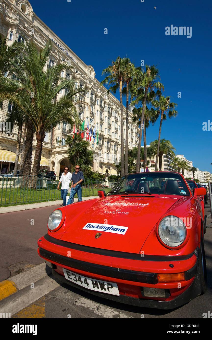 Porsche on front of Hotel Carlton, Croisette in Cannes, Cote d'Azur, France - Stock Image