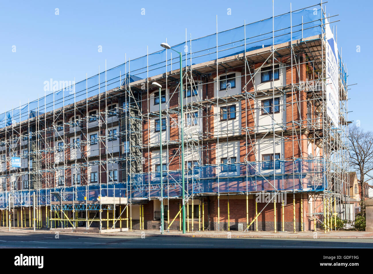 Scaffolding on all sides of a residential building, Nottingham, England, UK - Stock Image