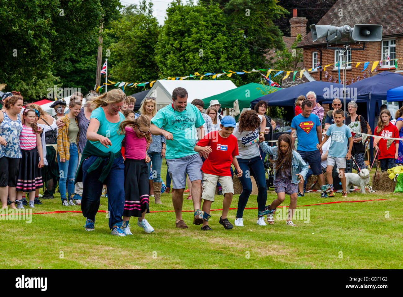 Families Take Part In A Traditional Three Legged Race At Fairwarp Village Fete, Fairwarp, East Sussex, UK - Stock Image