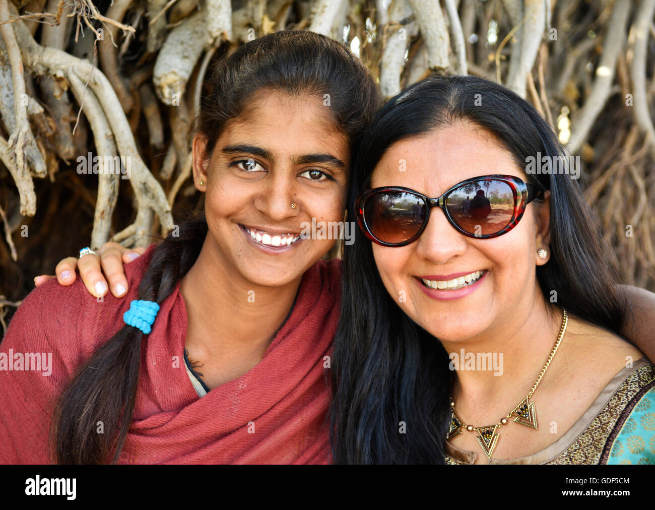 A dream come true for union of two beautiful females meeting with emotions of great joy and memories of true family - Stock Image