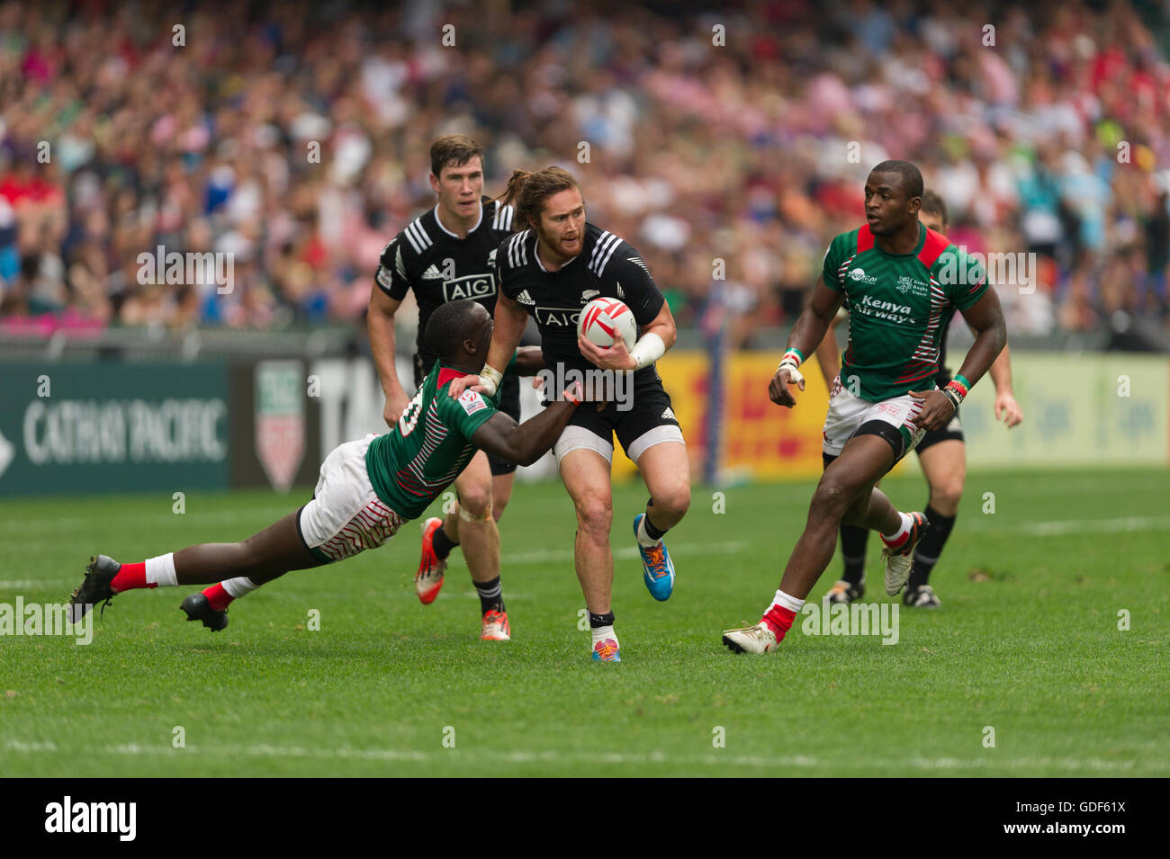 Rugby Sevens action, Gillies Kaka of New Zealand, running with the ball, Hong Kong Stadium, China. - Stock Image