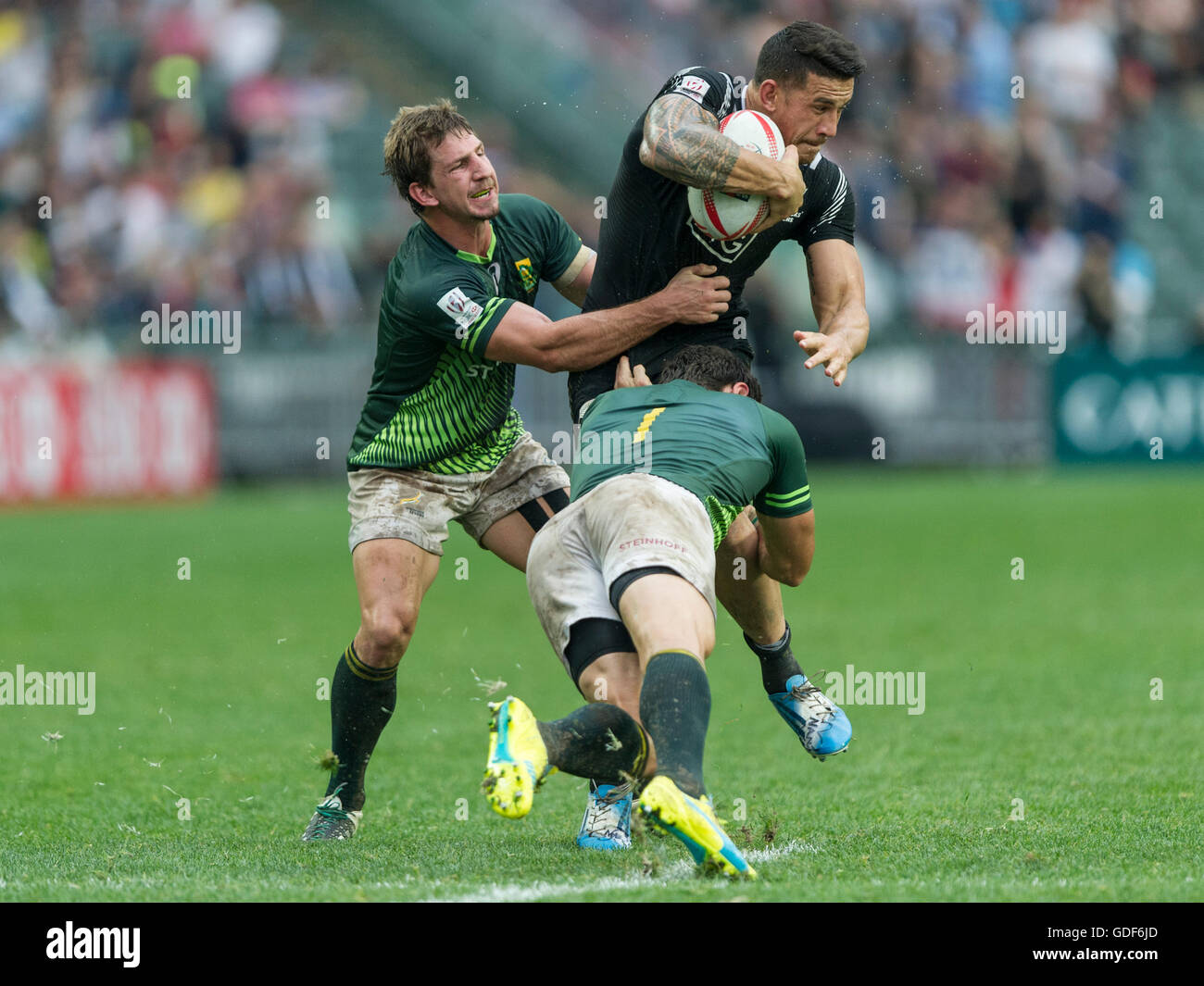 Sonny Bill Williams of New Zealand gets tackled by South Africa players Kwagga Smith and Ryan Kankowski. - Stock Image