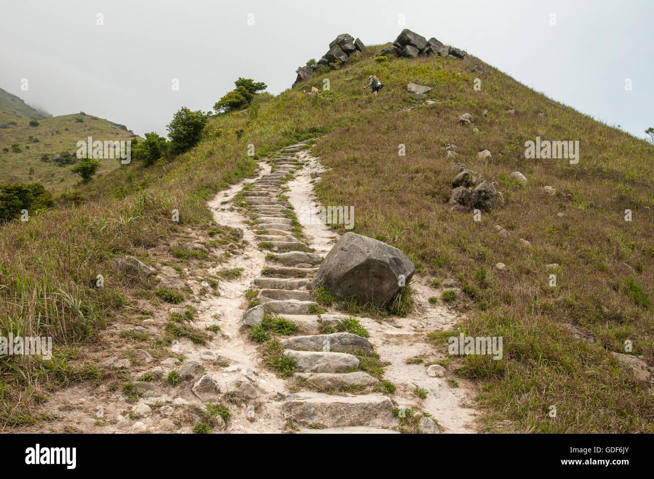 Stone steps give access to Sunset Peak (Tai Tung Shan ) Lantau Island Hong Kong, China. - Stock Image