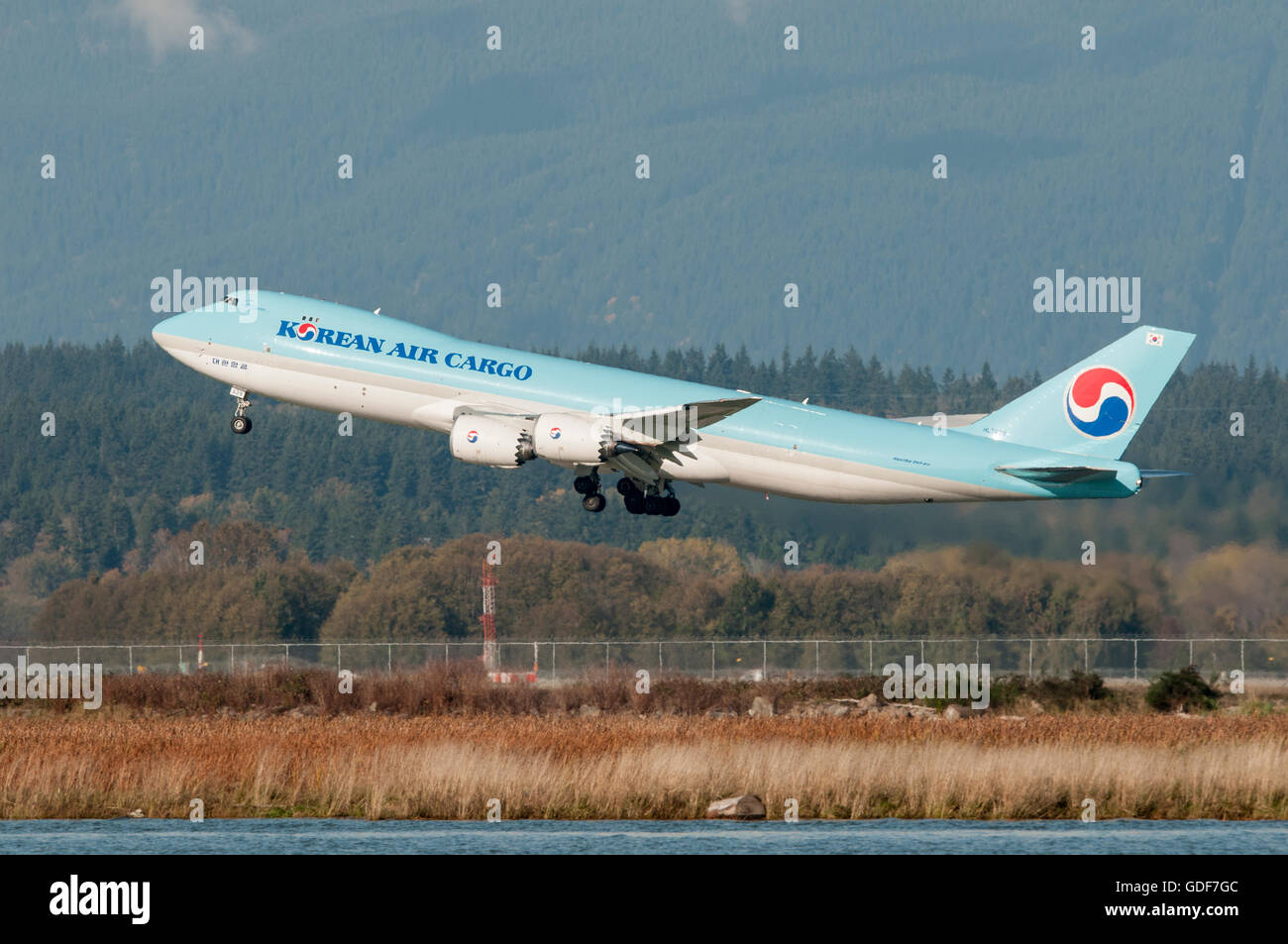 Korean Air Cargo Wide Body Boeing 747-8B5(F) taking off from Vancouver International Airport. - Stock Image