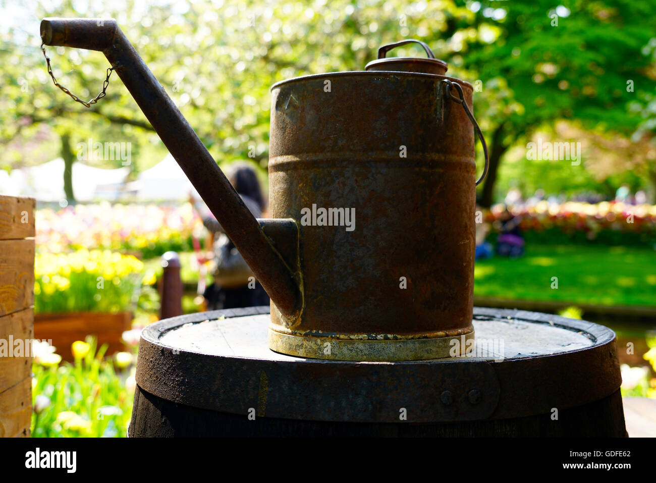 closeup of a rusty watering can - Stock Image