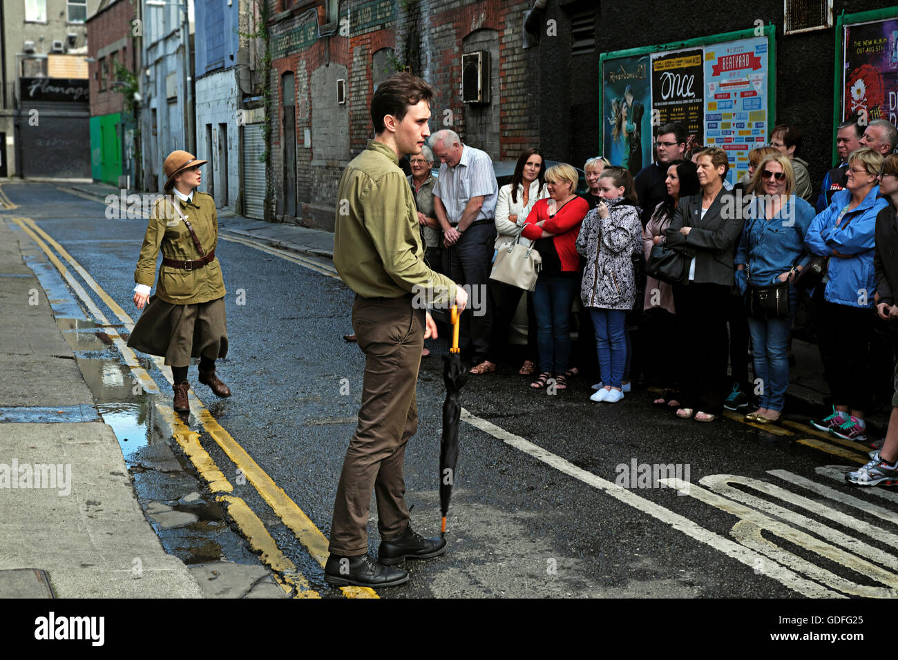 Irish re-enactment members stage an incident from the 1916 Easter uprising in Dublin Near Moore Street - Stock Image