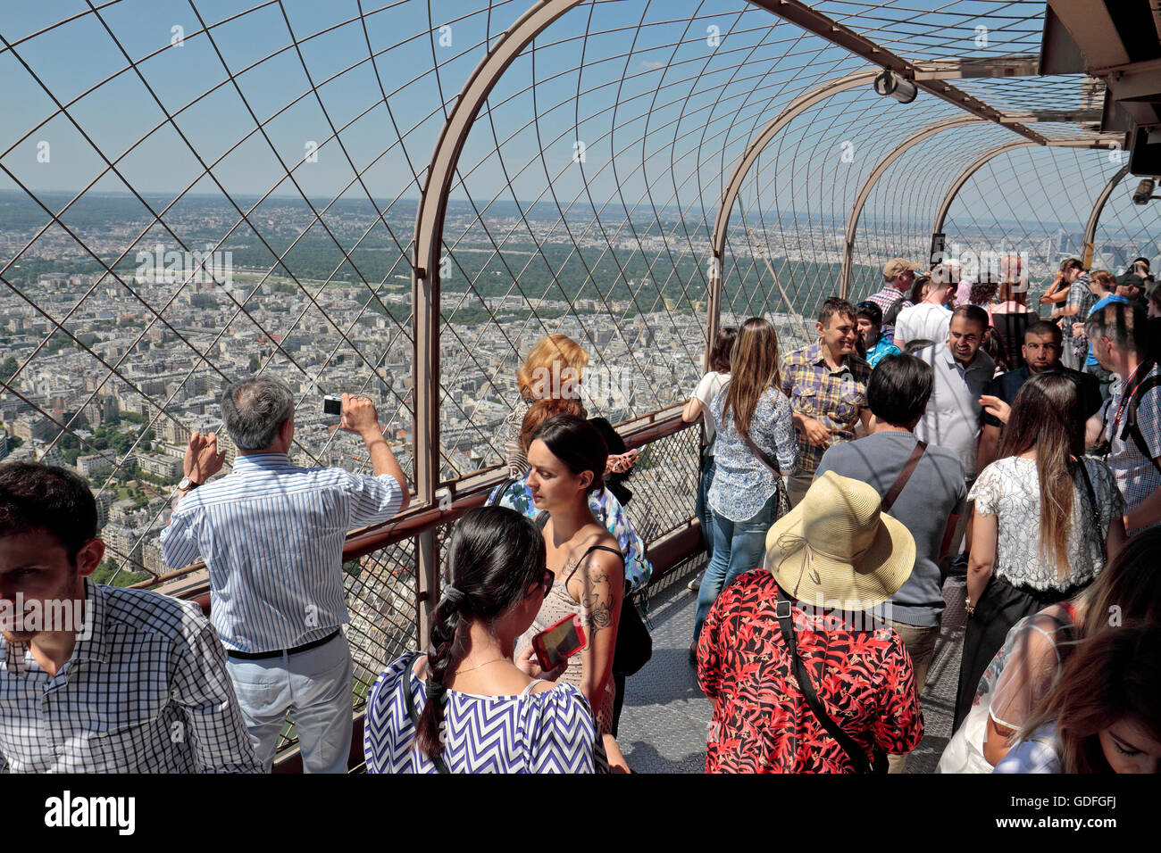 Tourists on the upper level walkway of the Eiffel Tower in Paris, France. Stock Photo