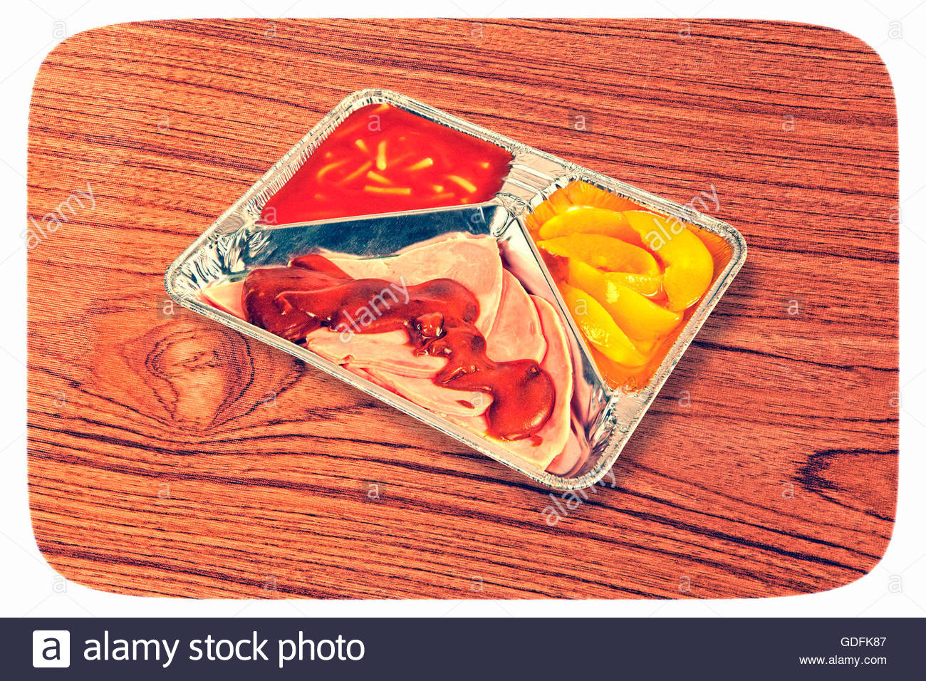 TV dinner tray vintage retro meal aluminium food dish on wooden table Stock Photo