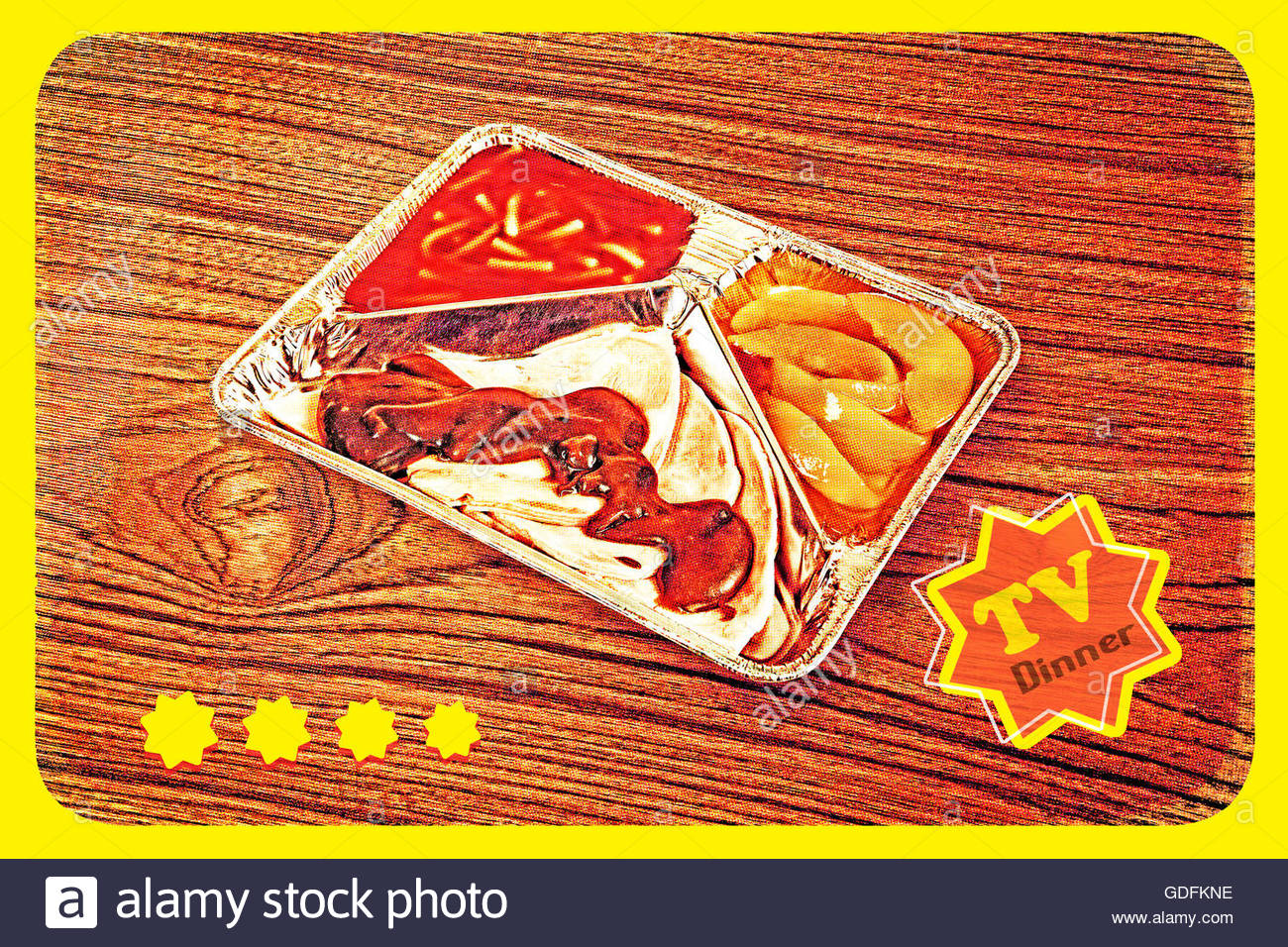 TV dinner tray vintage retro meal aluminium food dish on wooden table with dotscreen - Stock Image